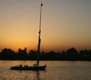 Felucca en la puesta del sol Foto de archivo libre de regalías