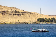 Felucca river boat on the Nile, with the Sahara behind in Aswa Stock Images