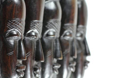 Fem afrikanska trämaskeringar Royaltyfri Foto