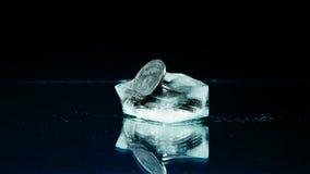 Fem cent i isen Arkivfoton