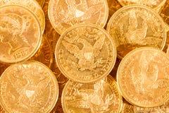 Fem dollar guld- myntar Royaltyfria Bilder