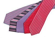 Fem eleganta silk manligties (slips) på vit Arkivbilder