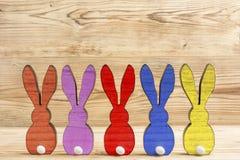 Fem färgrika easter kaniner Fotografering för Bildbyråer