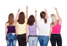 Fem flickor som pekar i kopieringsavstånd Royaltyfria Bilder