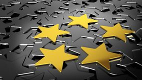 Fem guld- stjärnor på svarta stjärnor Royaltyfria Foton