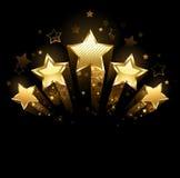 Fem guld- stjärnor Arkivbilder