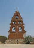 Fem klockor i ett torn Arkivfoto