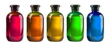 Fem kosmetiska flaskor Royaltyfri Bild