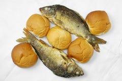 Fem loaves och de två fiskarna Arkivbild