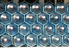 Fem plast- vattenflaskor för gal. Royaltyfri Fotografi