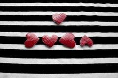 Fem röda hjärtor Fotografering för Bildbyråer