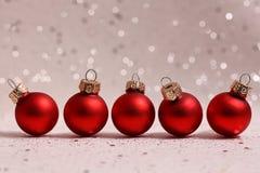 Fem röda julbollar Royaltyfri Bild