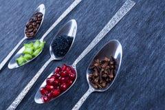 Fem skedar med mat och kryddor Royaltyfria Foton