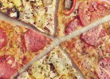 Fem skivor av pizza Arkivbild