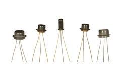Fem Sovjet-gjorda transistorer som isoleras på vit bakgrund Fotografering för Bildbyråer