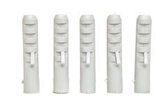 Fem stående plast- låspinnar Fotografering för Bildbyråer