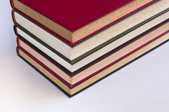 Fem staplade böcker royaltyfria foton