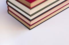 Fem staplade böcker royaltyfria bilder