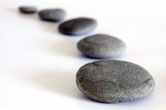 fem stenar Arkivfoton