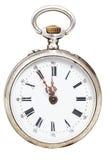 Fem till tolv klockan på visartavlan av den retro klockan Arkivbild