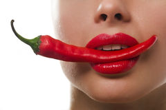 Femail mouth with red hot chilli pepper Royalty Free Stock Photos