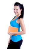 Femail Personal trainer. Studio shot of a Fitness girl or personal trainer isolated on white holding a diary, memo book Stock Images