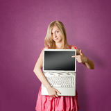 Femaile in pink with open laptop Royalty Free Stock Photo