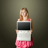 Femaile in pink with open laptop Royalty Free Stock Photos