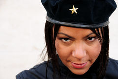 Femal Che. Young lady wearing black jacket and Cuban hat looking into camera lens with a reference to Ernesto Che Guevara in style Royalty Free Stock Photography