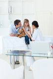 Femal doctor giving medecine to a patient. In the hospital Stock Images