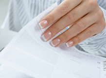 Femal hand turning page Royalty Free Stock Photos
