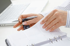 Femal hand turning page Royalty Free Stock Images