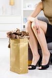 Femal hands packing out shopping bag Stock Photo