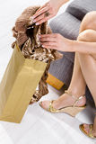 Femal hands packing to shopping bag Royalty Free Stock Photography