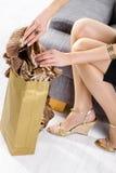 Femal hands packing to shopping bag Royalty Free Stock Image