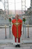 Femal minister in chasuble Stock Photo