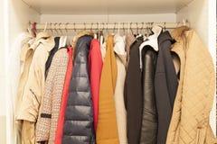 Femal wardrobe. With winter and summer jackets Royalty Free Stock Photos