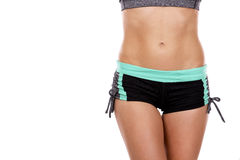 Female abdomen. Beautiful abdomen of young caucasian athlete on white background Royalty Free Stock Photography