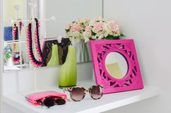 Female accesories on dressing table. Female accesories on white dressing table royalty free stock images