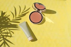 Female accessories Face powder Foundation Blush Make up Summer h. Female accessories, Face powder, Foundation Blush Make up Summer holiday concept Flat lay Top royalty free stock images