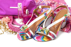 Female accessories. With shoes and perfume over white Royalty Free Stock Photos