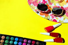 Hat, Sunglasses, Eye Shadow And Red Nail Polish. Summer Colorful Background. Summer Outfits. Female Accessories For Summer. Hat, Sunglasses, Eye Shadow And Red royalty free stock images
