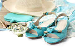 Female accessories with turquoise shoes. On white Stock Images