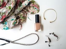 Female accessories on a white background. Female accessories such as scarf and nail polish on a white background Stock Photo