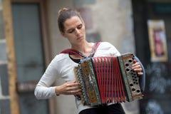 Female accordeon player. Stock Photo
