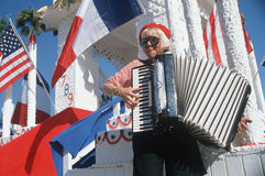 A female accordion player. Performing at the French Revolution Bicentennial Celebration, Hollywood Park, CA royalty free stock photography