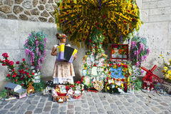 Montmarte Paris. A colourful accordion player in Montmartre, performs for visitors and tourists vising the nearby Sacre Coeur basilica. Montmarte Paris Stock Image