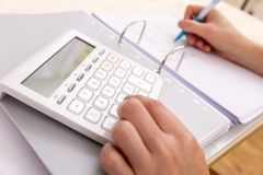 Female accountant or banker making calculations. Savings, financ. Es and economy concept Stock Images