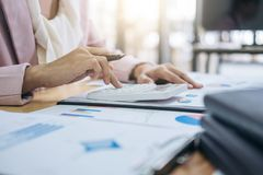 Female accountant calculations and analyzing financial graph dat Royalty Free Stock Photos