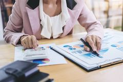 Female accountant calculations and analyzing financial graph dat Royalty Free Stock Images